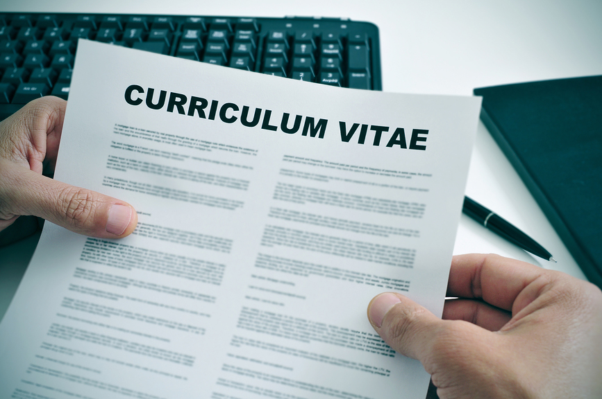man in his office checking a curriculum vitae