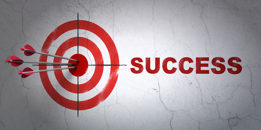 Success finance concept: arrows hitting the center of target, Red Success on wall background, 3d render