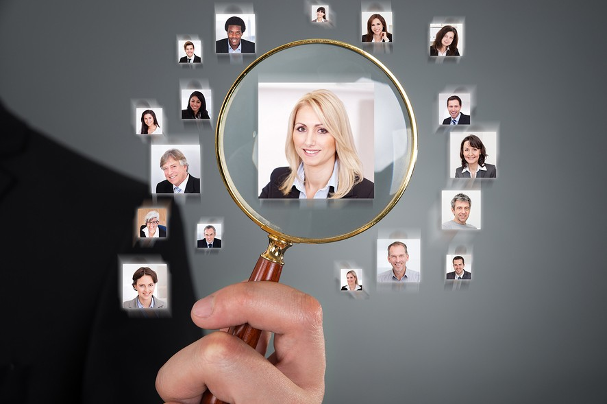 Businessman Searching Candidate With Magnifying Glass