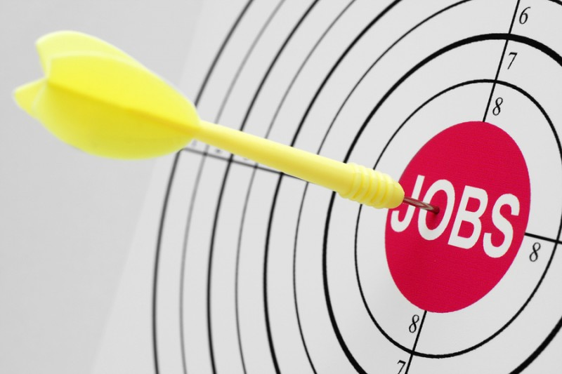 Close up of dart on jobs target
